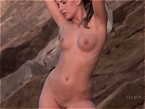 Whitney Conroy toying bare on the beach