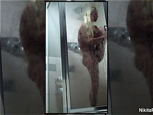 Home flick of Nikita Von James taking a shower
