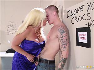 Alura Jenson pokes a dude in the cinema rest room